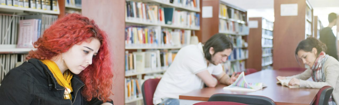 girl in library with books