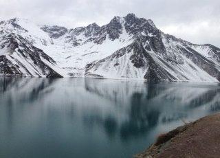 mountains next to smooth lake