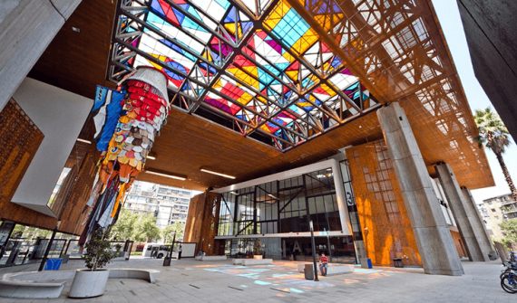 open plan building with colourful glass ceiling panes
