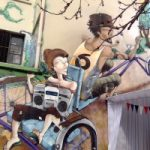 drawing of lady on back of a trike with stereo being cycled by man in vest
