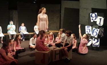 Still from Admiral Lord Nelson School's production of Matilda