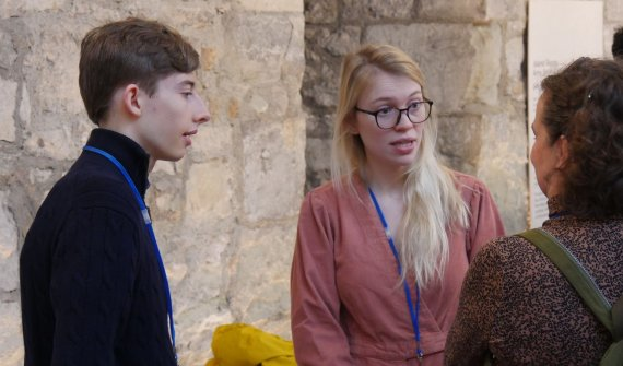 Image of Calvin talking to two Artswork colleagues at an event