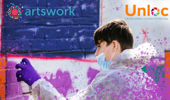 Young man spray painting on a wall wearing overalls, gloves and a face mask. Along the top line of the image is the Artswork and Unloc logos.